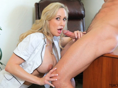 When Hollie Mack films Brandi Love making out with her student Johnny Castle, Brandi will do anything to keep her secret from getting out. She recognizes Hollie as the girl that's fucking another teacher, so she decides to make sure Hollie's cell phone has incriminating video of both of them. Hollie hesitates at first, but eventually she agrees to strip off her bra and thong so that she's naked on her own cell phone video. Now that she has Hollie naked, Brandi isn't about to quit ordering her student around.She tells Hollie to get down on her knees, and then guides her student's hand so that she's stroking Johnnie's cock. Soon enough she has coaxed Hollie's head down to give Johnny a deep throat blowjob. Always eager to enjoy herself, Brandi hands the camera off to Johnny so that he can film both girls sucking him off.Once Johnny is quivering with excitement, Brandi bends Hollie over the desk as an offering to fuck her. He spends a bit of time eating her out, but Brandi is impatient to watch him fuck Hollie so eventually he rises to his feet and sinks his stiffie into the warm wetness of Hollie's snatch.As much as she loves watching, Brandi isn't about to be denied the pussy pounding that she desires. Hopping onto the desk, she spreads her legs so that Johnny can fill her landing strip snatch with his big dick and then go to town pumping his hips. Hollie soon finds herself on her knees licking Brandi's twat as Brandi continues to find ways to encourage her to help out.Next, Hollie sinks down onto Johnny's lap and gives herself a stiffie ride while Brandi shows off her gorgeous ass for Johnny's pleasure. Brandi is craving a ride of her own, and Johnny is happy to accommodate if only so he can watch her enhanced big tits bouncing.Still not quite convinced that Hollie is going to keep her mouth shut, Brandi orders her to lay her face down on the desk and take another pussy pounding from behind. By this point Hollie is obviously loving it as indicated by her moans and t