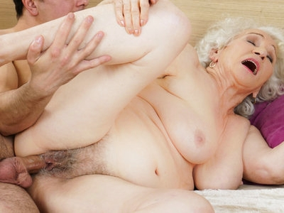 Busty granny Norma shared a bed with young Rob.