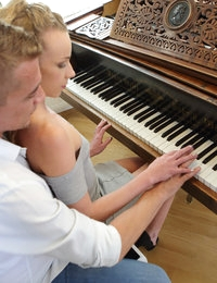 Hunky piano teacher intends to seduce his beautiful student – a gorgeous blonde with perky tits and small, tight ass. She is eager to learn and can teach a few oral exercises in addition to sweet piano tunes. Tempting babe prefers to go south and lick the boner in her teacher's pants. The guy quickly makes her choke with a big pulsating cock. To make the blonde prepared for a hot night the man eats her wet pierced pussy. Oral caress ends with orgasms for both horny lovers.