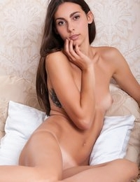She has tiny boobs on that skinny body of hers, but she has a lot of other was to seduce you with her looks.
