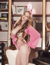 She will not hide her big beautifully breasts when she is in that sexy bunny costume, and wants to show the rest.