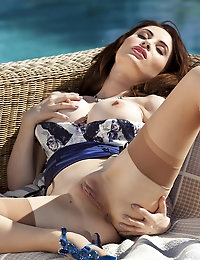 Layla Summers slides her bra around her perfectly round breasts