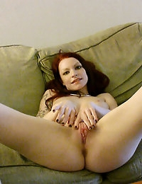 Sexy tattooed babe with nice big tits and shaved pink pussy stretches her nice pussy out with dildo toys