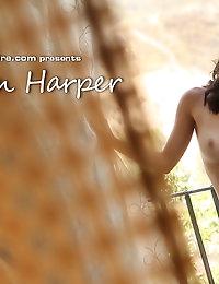 Dillion Harper slowly strips down by an open window