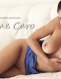 Jasmine Caro plays with herself on a couch