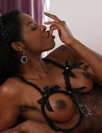 Sexy ebony babe takes a messy cumshot on her mouth