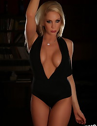 Busty blonde Alluring Vixen babe Eden shows off her huge perfect boobs in a very skimpy outfit that barely keeps them covered