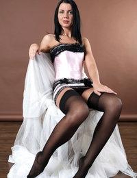 Glamorous model Macy in her black stockings looks like a queen