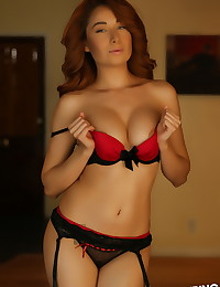 Beautiful Alluring Vixen tease Lilly shows off her curves in a skimpy red and black bra with matching panties
