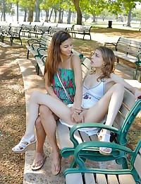 Back when I first shot Kristen as a first timer, I liked her attitude, easy to work with in public nudity, and her surprise extreme nature. She became a possible candidate for shooting in Hawaii, and it ended up happening back in February. My girlfriend, Nina, joined up, and became the 'assistant' on the shoot, along with her joining in on the fun once in a while. We started on the Waikiki strip, with both girls wearing cute dresses & wedges. Its a busy morning, and these girls start making out with a lot of PDA in public, then some upskirt views of Kristen and her cute white panties. We visit a very fancy resort, and quite secretly we try to shoot there without getting caught, as Kristen takes her panties off and starts spreading. Curious security, a wedding shoot etc... all right behind those windows made it all about proper timing and looking like tourists just relaxing... not shooting porn. Then we head over to a park, where there are ducks etc... and its all about Kristen and upskirt views of her long labia sticking out. Nina tugs on her pierced nipple, then makes out with her -- and they head over to some benches at the park where it gets very explicit. Starts with finger banging, then masturbating -- and long labia stretching and butt cheek spreads afterwards. What you don't see or hear is the homeless woman off camera behind me, who started raging about what we were doing, calling us 'pedophiles' etc... and the police officers that were stopping drivers nearby giving them tickets for going 8 over. And somehow I could not escape construction noises or leafblower noises no matter where I went heh. Also, between clips 3 and 4, it wasn't a smooth transition that it may seem in the videos, but a 5 hour break in between. Kristen got violently sick with food poisoning, and was completely out of it. I had her sleep, take gatorade, etc... while me and Nina went out hiking and other things (Like the Diamond head hiking photos of Nina you see on the last photo set). Fo